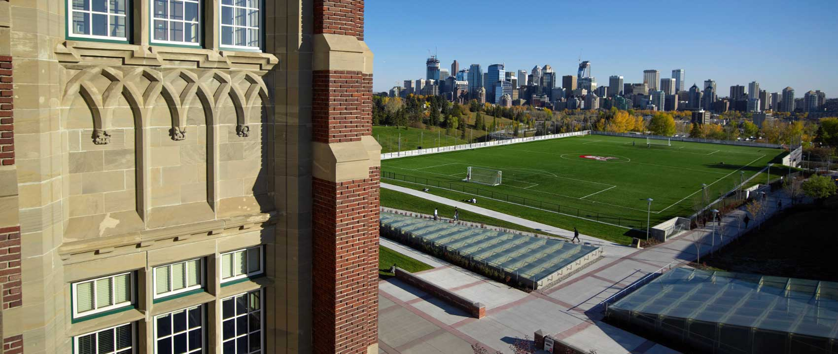 Exterior photo of Heritage Hall and the soccer field at SAIT